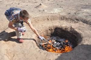 me feeding fire, early on, 3